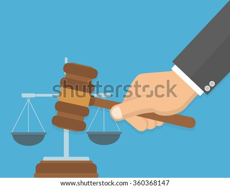 Equality in front of the law or fair decision concept. Hand holding judges`s gavel with a justice balance in the background. Flat design