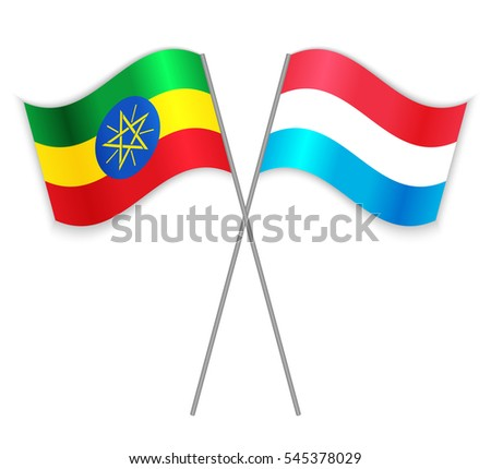 Ethiopian and Luxembourgish crossed flags. Ethiopia combined with Luxembourg isolated on white. Language learning, international business or travel concept.