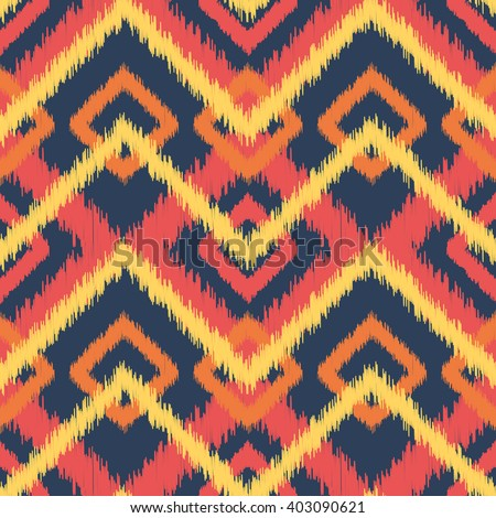 Ethnic pattern in bright red, orange, yellow and indigo colors; vector seamless background; Aztec and Indonesian decorative technique