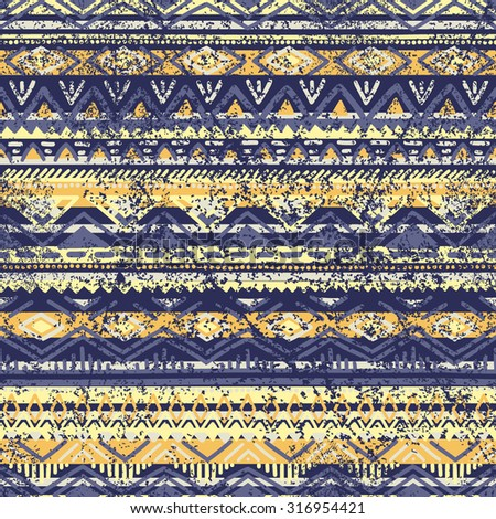 Ethnic seamless pattern. Blue and yellow color. Grunge. Vector illustration handmade.