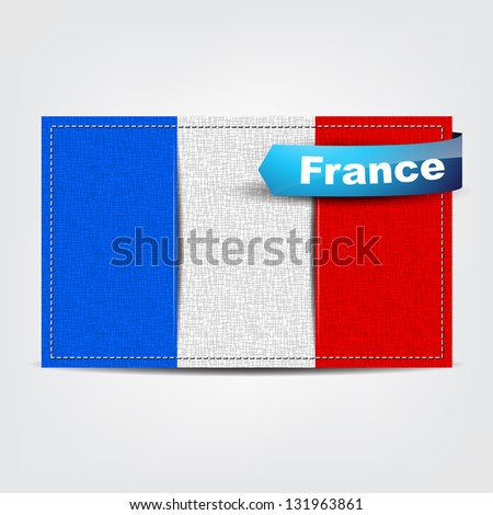 Fabric texture of the flag of France with a blue bow.