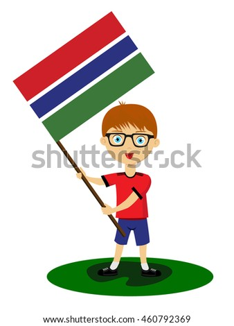 Fan of Gambia national football team, sports. Boy with flag in the colors of the state command with sports paraphernalia.