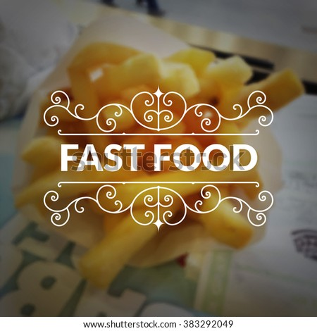 Fast food logo retro vintage typography lettering on blurred French fries background.