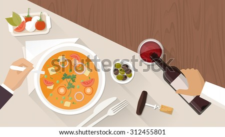 Fine dining at restaurant, a customer is eating a tasty soup and a waiter is pouring wine in a glass - stock vector