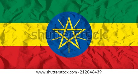 Flag of Ethiopia on wrinkled paper vector illustration. - stock vector