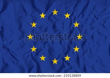 Flag of European Union on wrinkled paper vector illustration. - stock vector