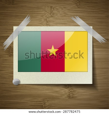 Flags of cameroon at frame on wooden texture. Vector illustration - stock vector