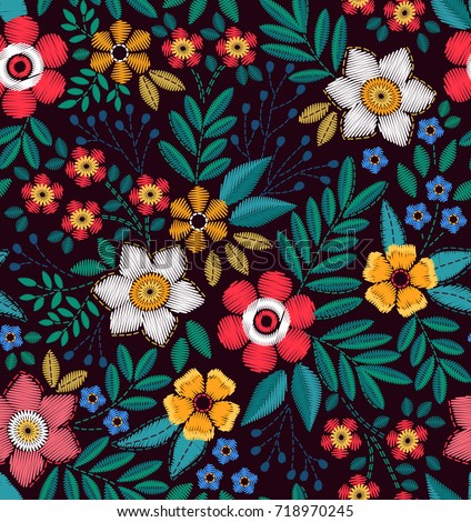 Floral background in vintage style. Vector seamless pattern. Decorative embroidery flowers. Ornament for textiles on black background. Colorful flowers. The elegant the template for fashion prints.