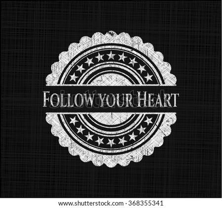 Follow your Heart chalkboard emblem written on a blackboard - stock vector