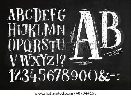 Font pencil vintage hand drawn alphabet drawing with chalk on chalkboard background.
