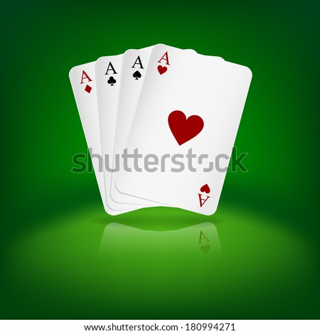 Four aces playing cards on green background