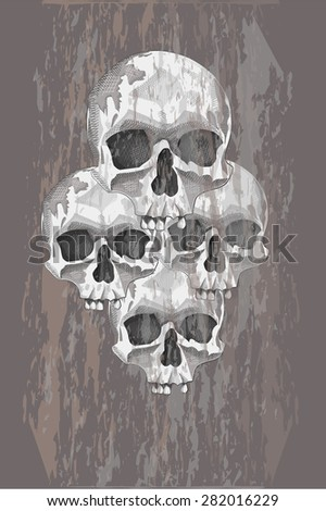 Four skulls on a gray background