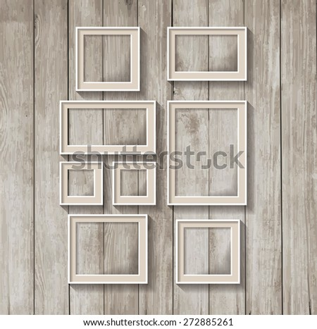 Frame template. Set of a frame on a wooden wall - stock vector