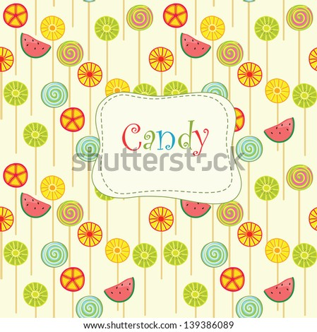 Fruit lollipops on the yellow  background