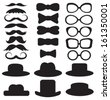 gentleman's set consists of a hat, glasses, mustache and bow ties - stock photo