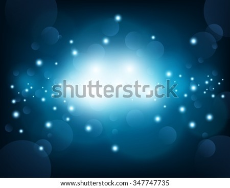 Glowing blue sparkling with lens flare background