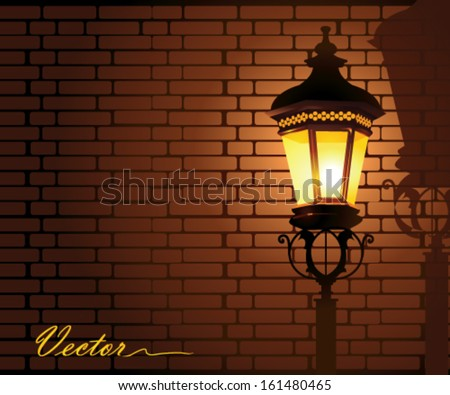 glowing street lamp against a brick wall at night - stock vector