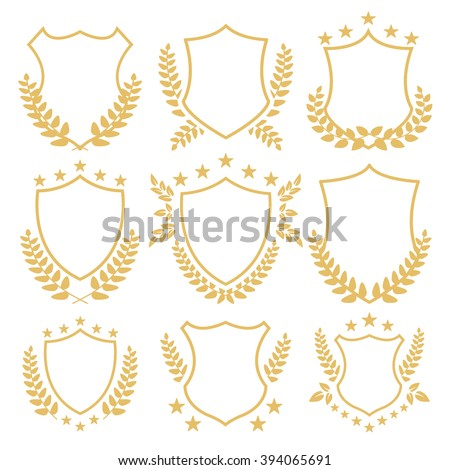 Gold shields and insignias set. Decorative golden shields with laurel wreath and stars. Vintage badges set isolated on white background - stock vector