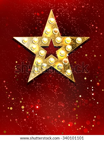 gold star with lights on red velvet background.