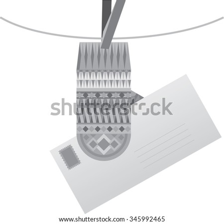 gray ornate mitten on a clothespin with a letter