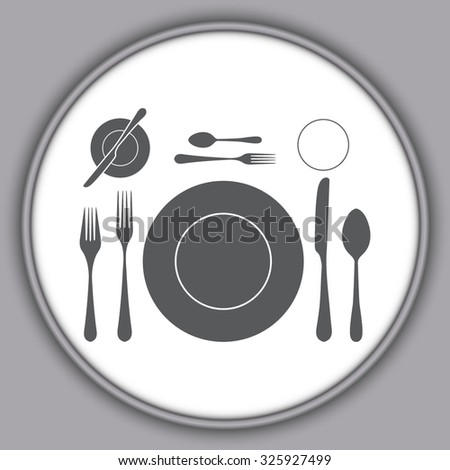 Gray plate with spoon, knife and fork