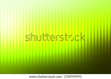 Green abstract blur colored background with defocused vertical rays of light.