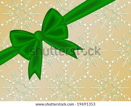 Green Christmas holiday ribbon bow against snowflake background to look like gift package.