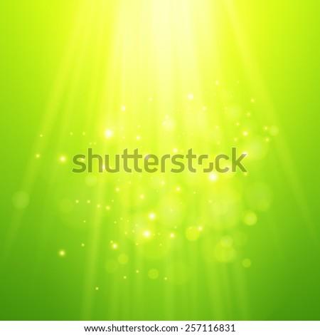 Green rays of light. Vector bokeh blurred background - stock vector