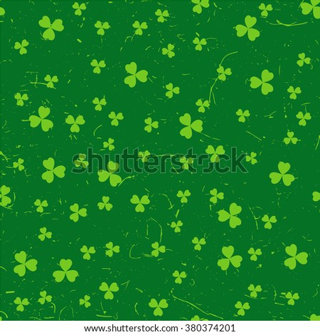 Green St. Patrick's day pattern with clover leaves over grunge background. - stock vector