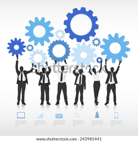 Group of business people holding gears.