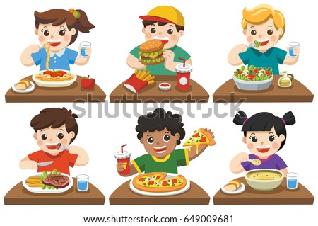 Group of Happy Kids eating delicious food on the dining table.