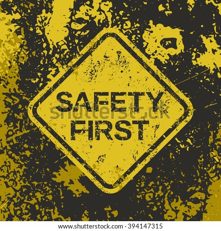 "Grunge poster ""Safety First"". Vector illustration of ""Safety First"" sign on grunge dirty yellow backdrop. It can be used as a poster, wallpaper, t-shirts design. Fully editable file for your projects. - stock vector"