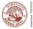 Grunge rubber stamp with the Mount Nanda Devi, second highest mountain in India, vector illustration - stock photo