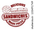 Grunge rubber stamp with the word sandwiches written inside, vector illustration - stock vector