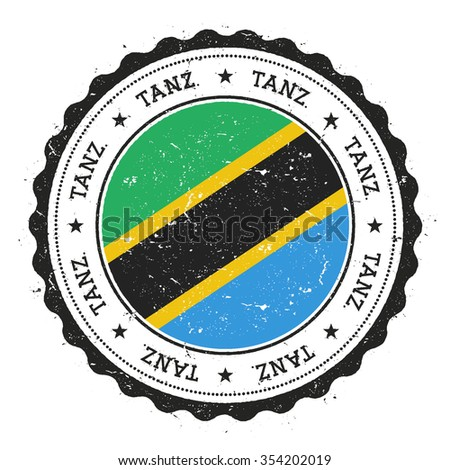 Grunge rubber stamp with United Republic of Tanzania flag. Vintage travel stamp with circular text, stars and country flag inside it, vector illustration - stock vector