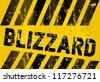 Grungy blizzard warning sign, vector illustration - stock vector