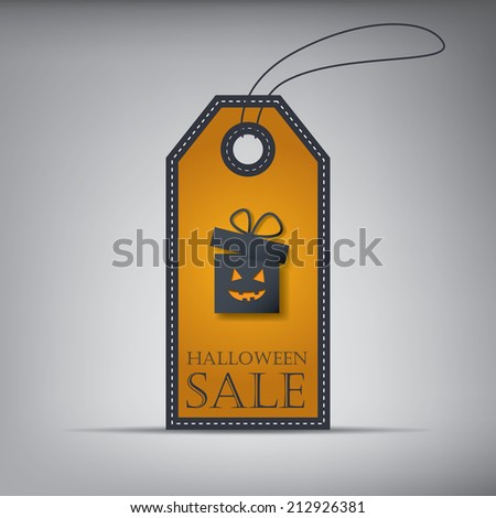 Halloween sales tag with gift box. Eps10 vector illustration. - stock vector