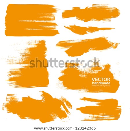 Hand-drawing orange textures of brush strokes in random shape - stock vector