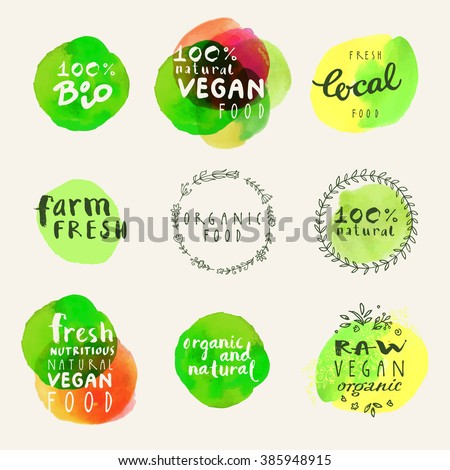 Hand drawn badges and labels collection. Retro style set of 100% bio, organic, vegetarian, vegan, raw, eco, healthy food label templates with floral vintage elements and watercolor splashes. Vector
