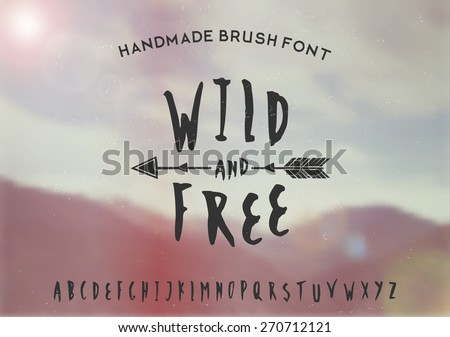 Hand drawn brush font on a blurred vintage style mountain view background. EPS 10 file, gradient mesh and transparency effects used. - stock vector