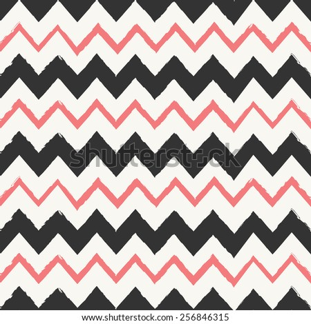Hand drawn style chevron seamless pattern. Abstract geometric tiling background in black and pastel coral red. - stock vector