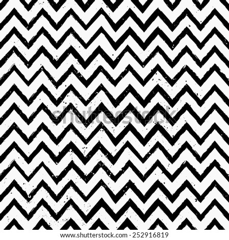 Hand drawn style chevron seamless pattern. Vintage zig zag repeat pattern in black and white. - stock vector