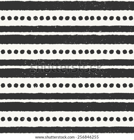 Hand drawn style ethnic seamless pattern. Abstract geometric tiling background in black and off-white. - stock vector