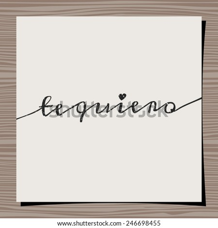 Hand-drawn style typographic design for Valentine's Day. Paper note on wood background mock-up. Te quiero - I love you in Spanish. - stock vector