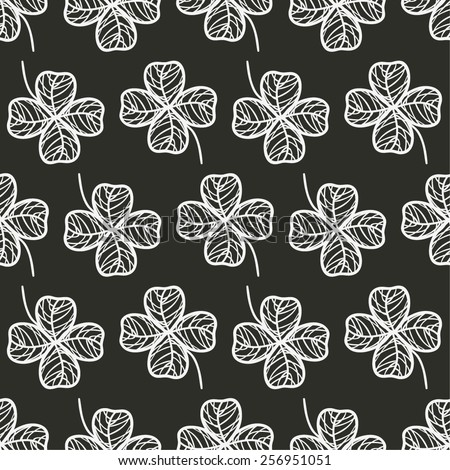 hand drawn stylized shamrock arranged in lines seamless pattern, saint patrick holiday design background, black and white chalkboard vector illustration - stock vector