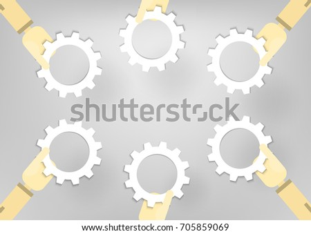 Hand hold gear wheels on grey background.
