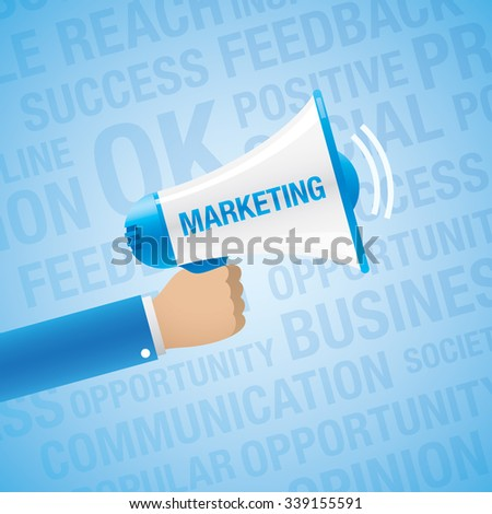 Hand holding a bullhorn with MARKETING sign, on a blue background. Business concept.