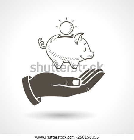 Hand holding a hand drawn vector piggy bank, vector icon. - stock vector