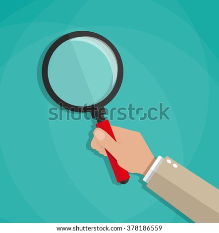 hand holding a magnifying glass - stock vector