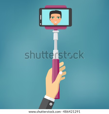 Hand holding monopod, tool for take self portrait for smartphone.
